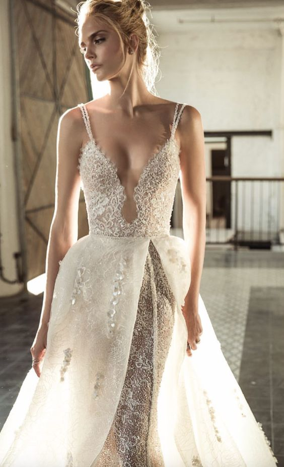 a fantastic textural lace and bead spaghetti strap wedding dress with a covered plunging neckline and a rhinestone overskirt for the ceremony