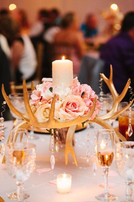 a glam gilded antler centerpiece with crystals, pink roses and a candle