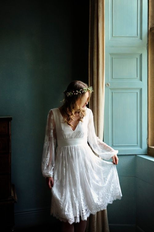 a lace wedding dress with bell sleeves, a V-neckline and a lace skirt for a romantic countryside bride