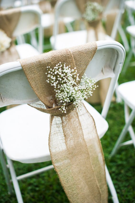 burlap to tie the chair and baby's breath for a beautiful touch are perfect for a rustic wedding