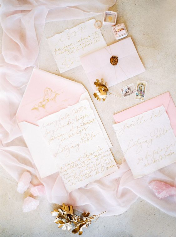 cutest pink wedding invitations with gold calligraphy, seals and threads for a glam wedding