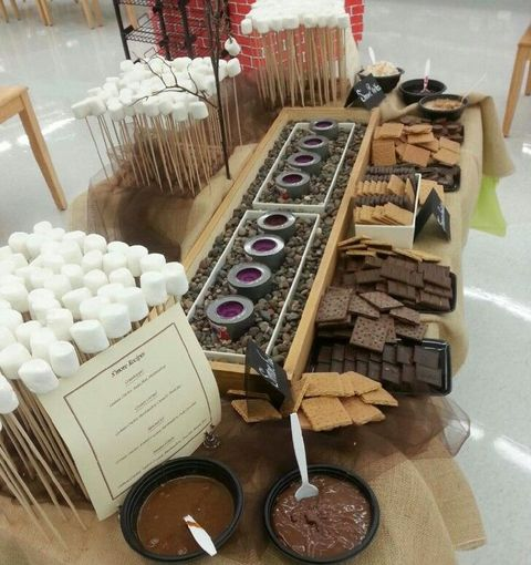 a chic s'mores bar with marshmallows, cookies and chocolate is a gorgeous idea for warming up