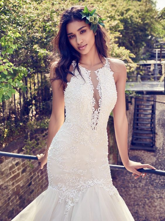 a gorgeous halter and illusion plunging neckline mermaid wedding dress with a textural bodice