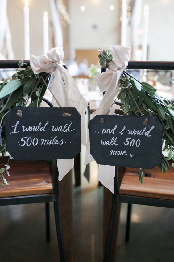 chalkboard wedding signs with fresh greenery and blush ribbons   write whatever you want on them