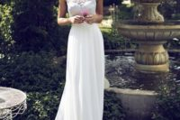 21 a halter neckline wedding dress with a lace bodice and a ruffle collar, a plain skirt