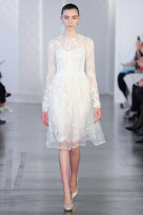 sheer layers and floral detailing make for a romantic walk down the aisle, a gown by Oscar de la Renta