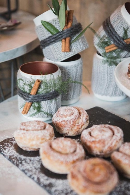 serve cinnamon buns instead of a wedding cake, cover mugs with cozies, fern, cinnamon sticks and twine