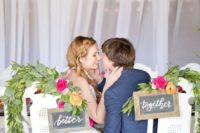 22 simple rustic chalkboard signs, lush greenery and bold blooms for wedding chair decor