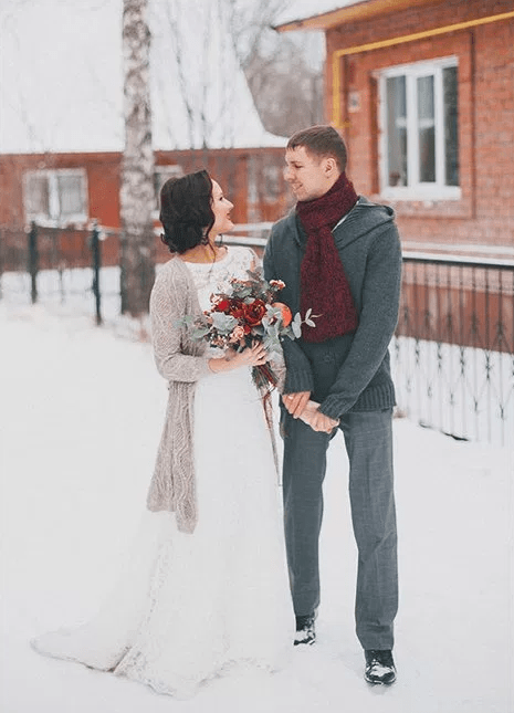 a dove grey knit long cardigan for the bride and a warm grey sweater and a scarf for the groom