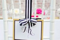 23 a glam wedding sign with gold glitter, framing and black and white striped bow for a cute wedding