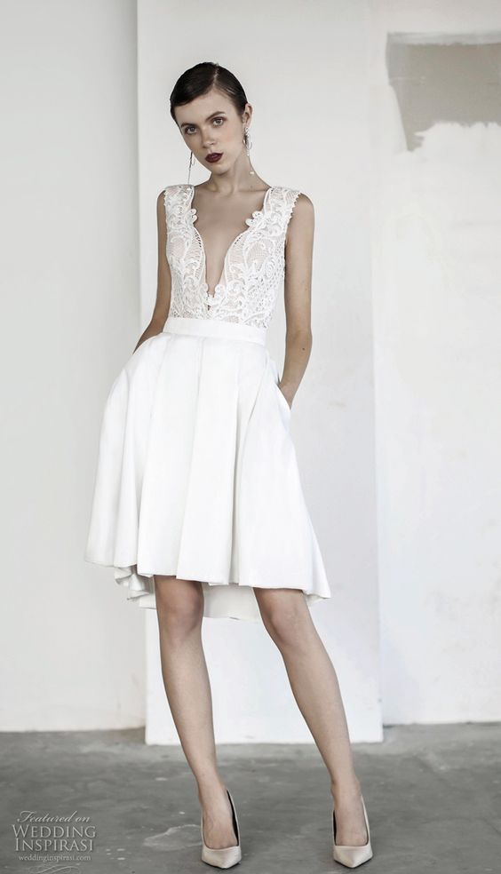 a plunging neckline wedding dress with a lace sleeveless bodice and a pleated skirt is a very sexy idea