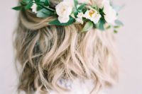 23 a wavy hairstyle with fresh white blooms and greenery on the back for a romantic bride