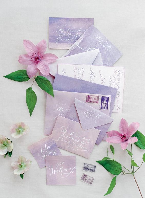 gorgeous lavender and pink watercolor wedidng stationery with white letters for a colorful summer wedding