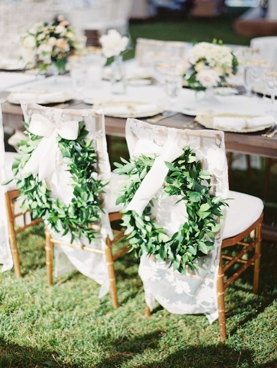 lace covers and foliage wreaths for creative wedding chair decor