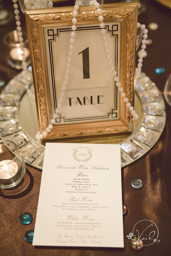 a glam table number with strands of perlas on a silver tray is a perfect fit for an Old Hollywood wedding