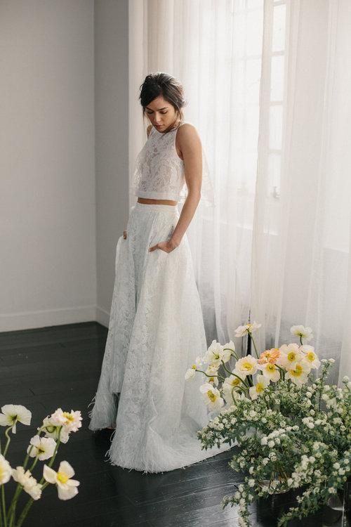 a lace bridal separate with a lace crop top and a full high low skirt with pockets is a chic idea