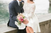24 a short wedding dress with a lace bodice, long sleeves and an A-line skirt and nude shoes to finish the ensemble