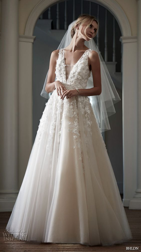 an illusion plunging neckline wedding dress with floral appliques looks sexy and romantic