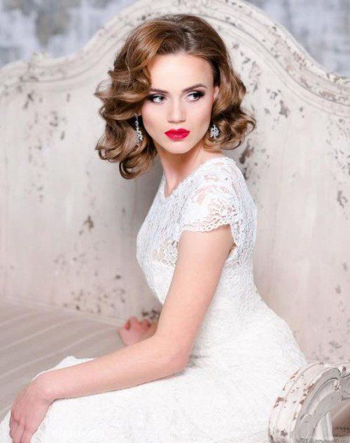 curly wedding hair looks very cute, chic and feminine, and will fit many bridal styles