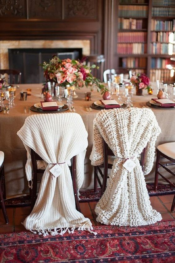 differently knit chair covers for the bride and groom instead of usual signs look very winter-like