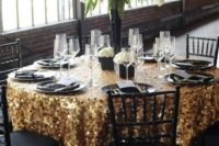 24 large gold square sequin tablecloth, black plates and vases for a chic New Year's Eve wedding