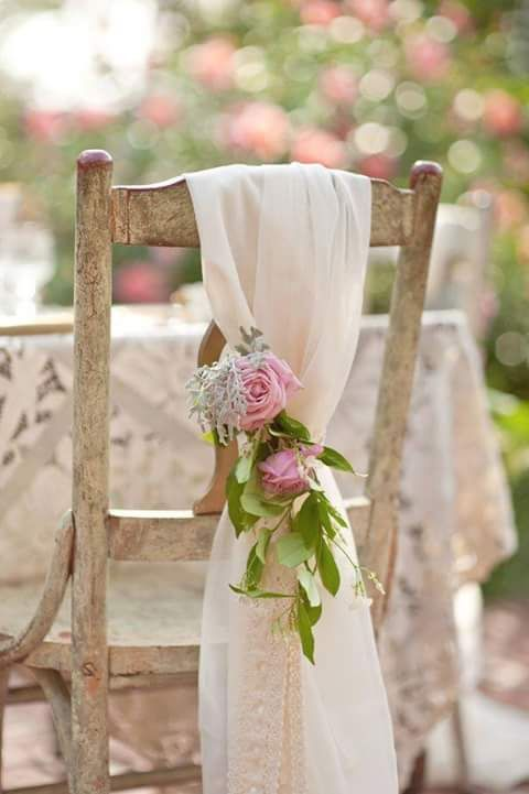 light airy white fabric with a pink floral posie and leaves for a vintage-inspired or garden wedding