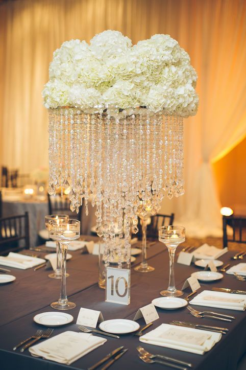 a glam white hydrangea and hanging crystals wedidng centerpiece for an Old Hollywood wedding