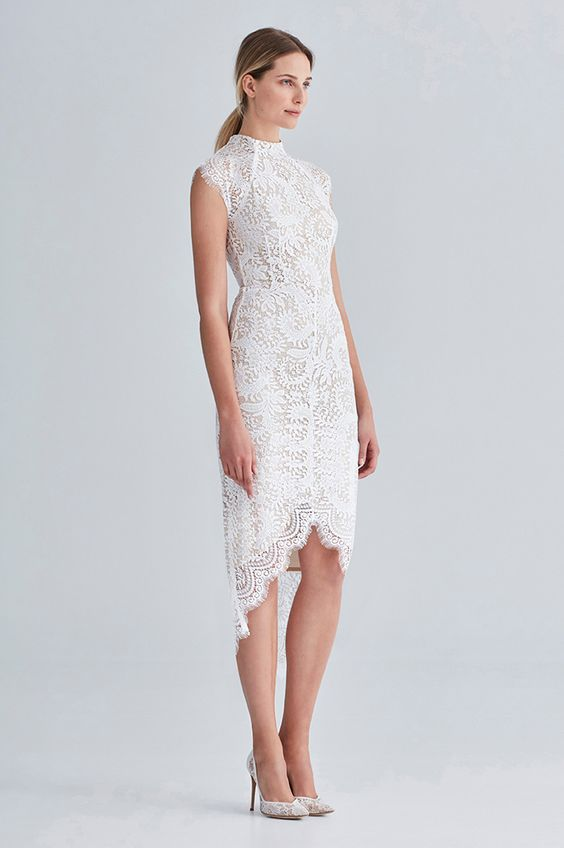 a turtleneck sleeveless wedding dress with a high low skirt of lace flatters all your curves at its best