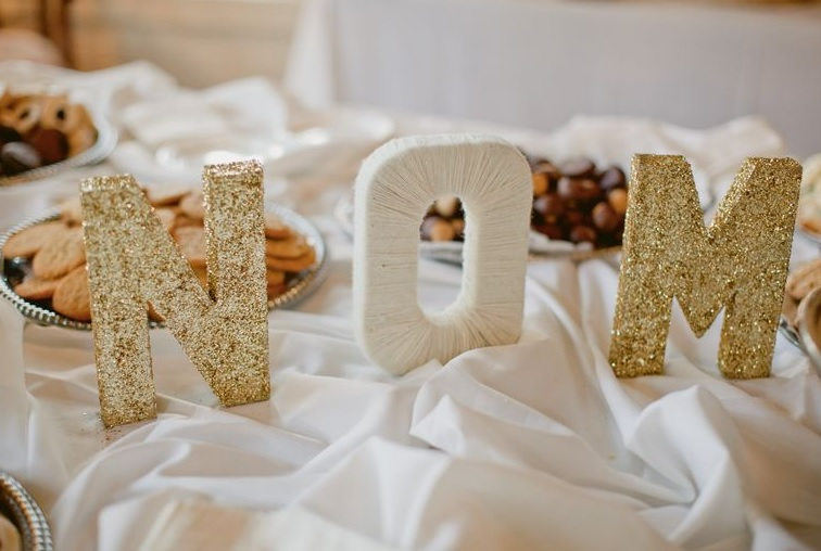 gold glitter letters with your inititals are a great idea to accentuate any wedding space