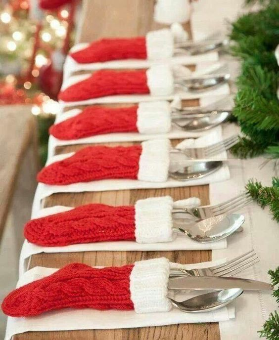knit red and white stockings as utensil covers for a Christmas wedding