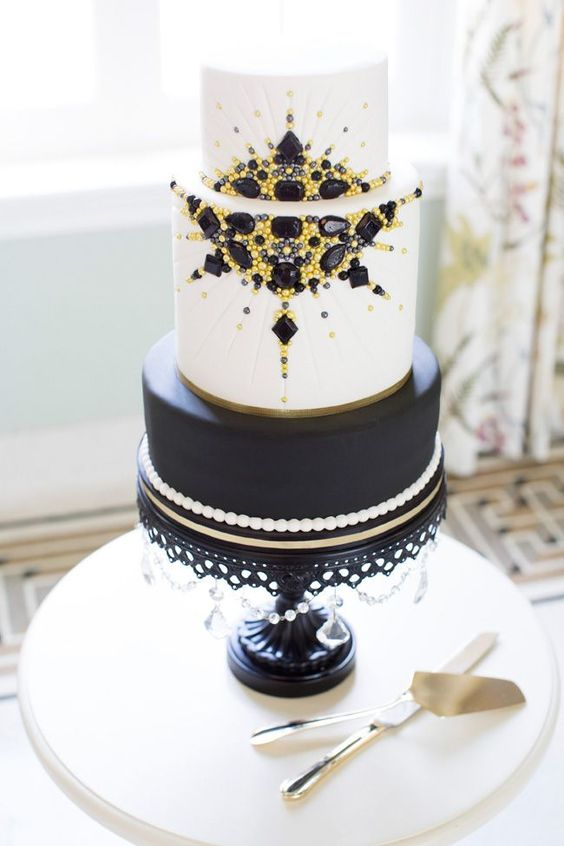 a black and white wedding cake with edible yellow and black beads and rhinestones looks wow
