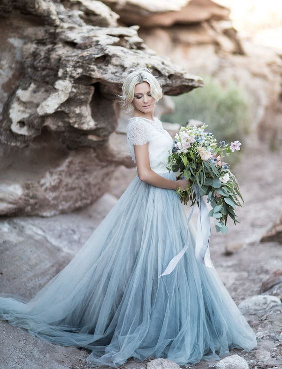 a lace short sleeve top with a blue tulle skirt looks trendy and ethereal and shows off winter shades