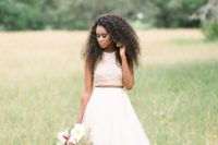 26 a textural halter neckline crop top, a layered skirt with ruffles for a chic and trendy bridal look