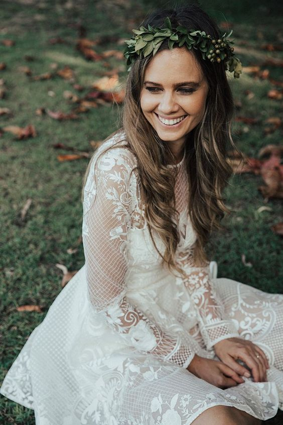 a unique boho lace wedding dress with long sleeves and an illusion neckline, lace appliques make it cooler