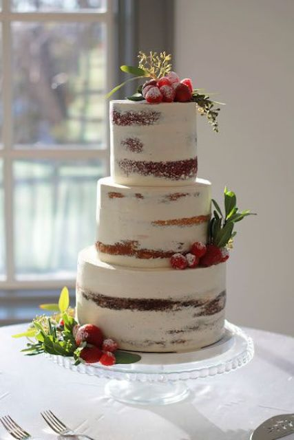 semi-naked wedding cake with berries and greenery for a rustic winter wedding