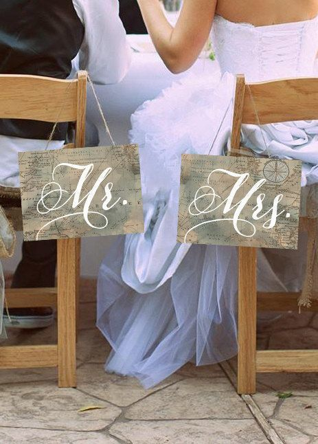 vintage map chair signs for a travel-inspried wedding or for a seaside one with sea maps