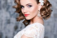 27 short curly bridal hair with a side pearl hairpiece to make a glam and girlish accent