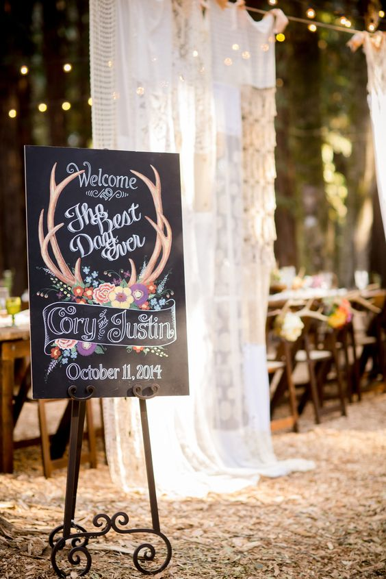 a chalkboard sign with antlers and bold flowers for cool colorful decor