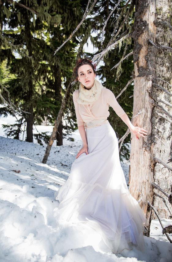 a simple bridal separate with a blush draped top with half sleeves and a layered full skirt plus a faux fur scarf for outdoor shots