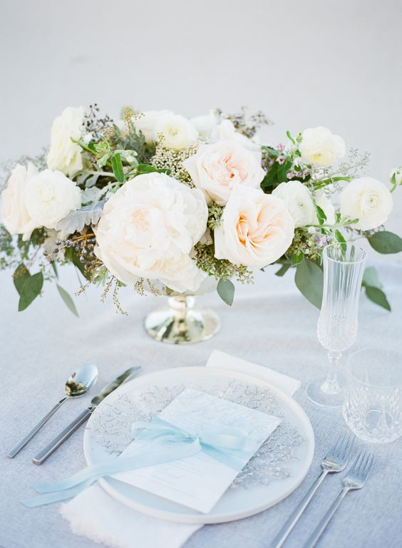 an ice blue ribbon, a silver snowflake and a sparkling tablecloth will create a proper ambience