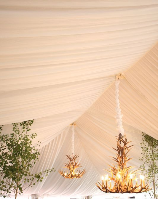 gorgeous antler chandeliers for a mountain wedding look unusual and bold