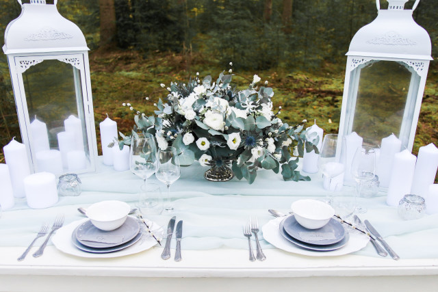grey chargers, an ice blue table runner and a pale green and white floral centerpiece are a great choice