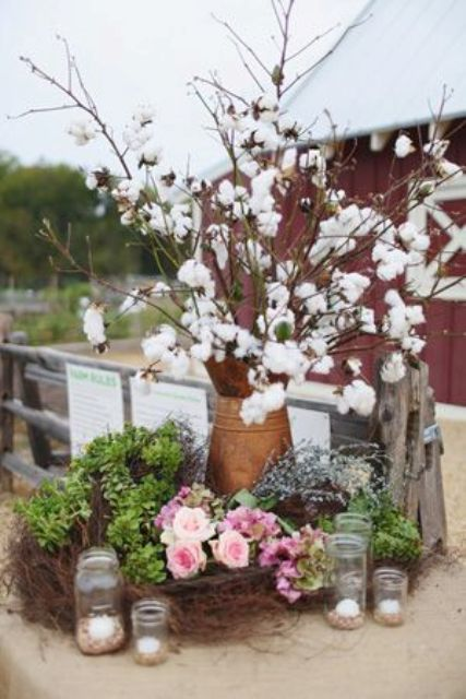 wedding decor with cotton branches, succulents, greenery and pink roses is amazing for a wedding venue