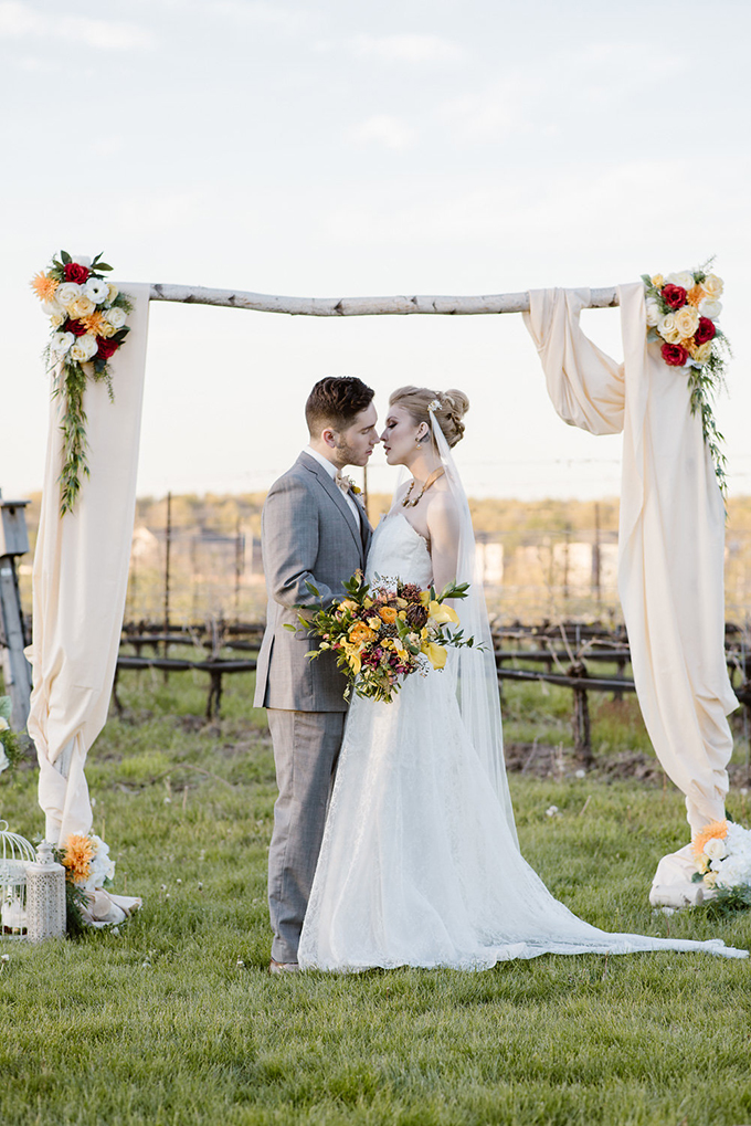 This vineyard wedding shoot was inspired by vintage vibes and bold fall colors