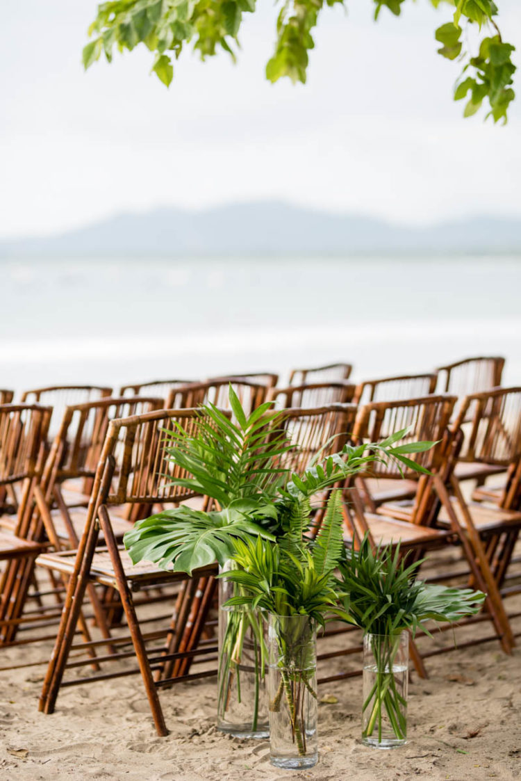 Flora was an important part of the wedding decor, and tropical leaves were used for the ceremony space