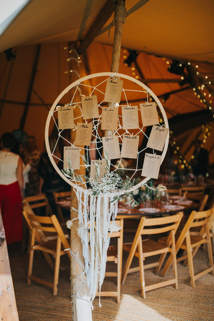 The bride made many decor elements herself, for example, large dream catchers like this seating chart