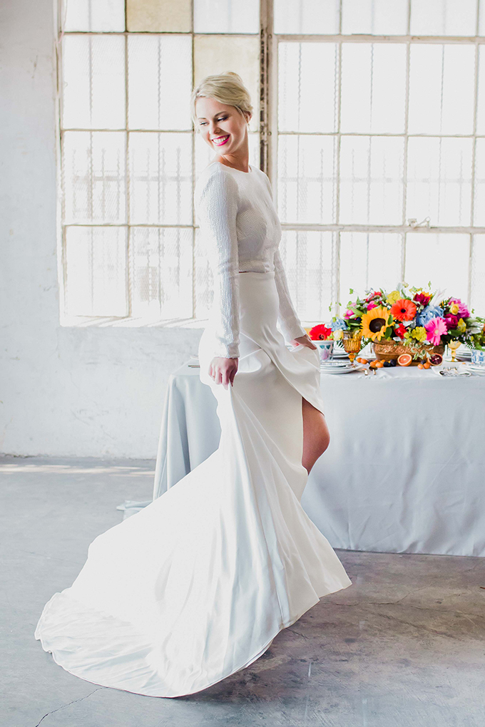 The bride was wearing a separate with a white sequin top and long sleeves, a creamy skirt with a train and an asymmetrical slit