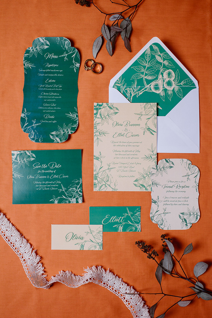 The wedidng stationery was done in emerald and gold, with various botanical prints