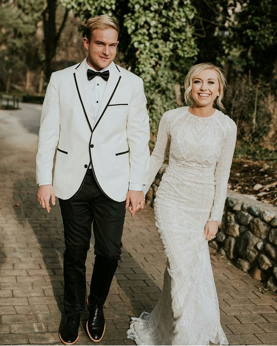 a high neckline sheath wedding dress with long sleeves, textural lace and beading