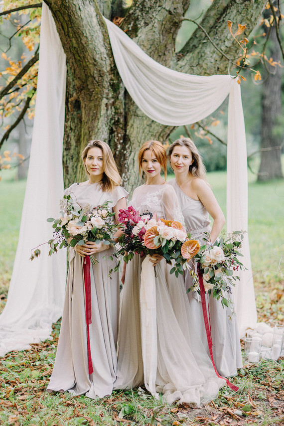 The bridesmaids were wearing dove grey dresses and carried blush rose and foliage bouquets